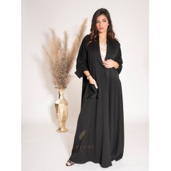 AS1013 Abaya with a unique modern design in crepe fabric with one pocket and pleats on the other side with a collar neck and two large buttons fastening in the middle