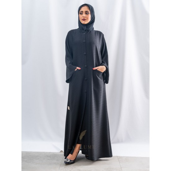 AS1017   Abaya characterized by its patterned fabric and comfortable feel with front pockets and the lock with six large buttons with a round neck the headcover not included