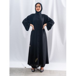 AS1018 A formal royal black crepe abaya with a mandarin neck and a closure with large buttons fitted with side pockets the headcover not included