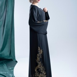 AK3005 A hand work Abaya in golden color, with a coordinated and elegant collection on the sides and sleeves, with crepe fabric