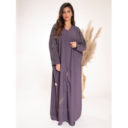 AK3018 A sophisticated butterfly design with a modern touch, hand work on the sleeves, with a colorful abaya, a v-neck, a narrow sleeve, and a locking button on the front