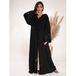 AK3020 Double chiffon abaya with a v-neck. There are flower branches from bottom to top in the middle behind the abaya and on the French sleeves
