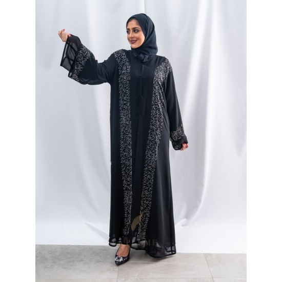 AK3040 Double chiffon abaya with a v-neck with one layer at the closure and the side of the sleeves and the hand work on the side of the double layer with random lines, which gives it an attractive look the headcover not included